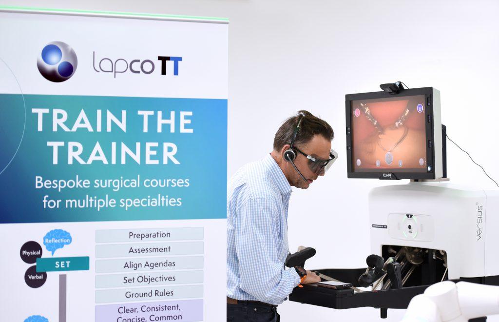 Surgeon demonstrating operating using a robot